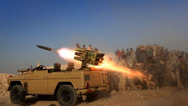 Iraqi Kurdish fighters fire a multiple rocket launcher from a position near the town of Bashiqa, some 25km north-east of Mosul, on 20 October 2016