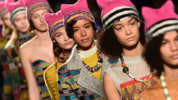 Models wearing pink hats walk the runway at the end of the show for fashion house Missoni during the Women's Fall/Winter 2017/2018 fashion week in Milan, on February 25, 2017.