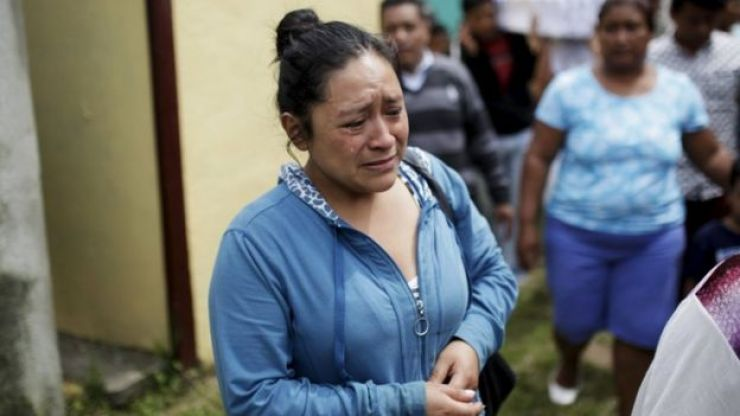Relatives participate in a funeral of two victims of a mudslide in Santa Catarina Pinula, on the outskirts of Guatemala City, October 3, 2015.