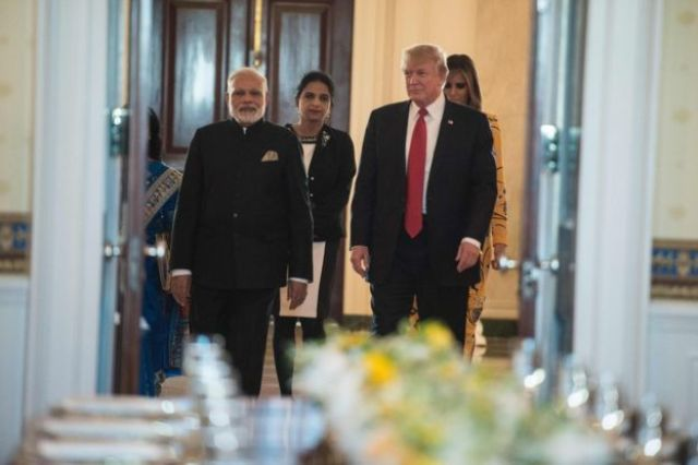 Indian Prime Minister Narendra Modi (L), US President Donald Trump (2nd R) and First Lady Melania Trump arrive in the Blue Room for dinner at the White House in Washington, DC, on 26 June 2017.