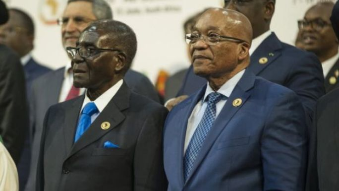 South African President Jacob Zuma (2nd R), African Union chairperson and Zimbabwean President Robert Mugabe (C)