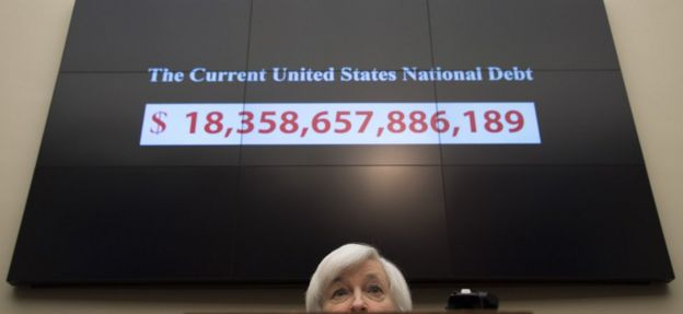 A graphic shows the rising current US national debt as Federal Reserve Chair Janet Yellen testifies before the House Financial Services Committee on Capitol Hill in Washington, DC, November 4, 2015