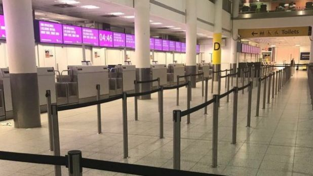 An empty check-in desk for Monarch Airlines is pictured at Gatwick airport