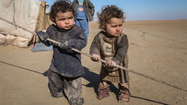 Internally displaced Syrian children who fled Raqqa city stand near their tent in Ras al-Ain province, Syria January 22, 2017