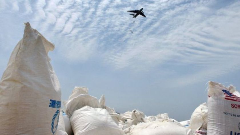 An airplane carries out an food-drop over a field at a village in Nyal, an administrative hub of Panyijar county in Unity state, south Sudan