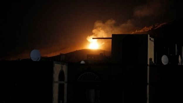 An explosion at a military arms depot is seen after it was hit by a Saudi-led air strike on the Nuqom Mountain overlooking Yemen's capital Sanaa (14 October 2016)