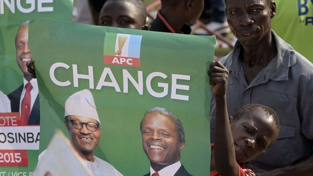 Boy holding a poster which says change