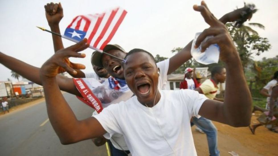Liberians cheer as they stand in line to enter the inauguration off the President-elect, George Weah, at the Samuel Kanyon Doe stadium, in Monrovia, Liberia, 22 January 2018.