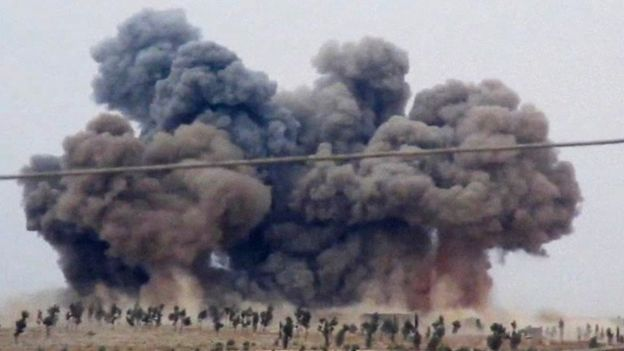 An image made from video shows smoke rising after airstrikes in Kafr Nabel of the Idlib province, western Syria, Thursday, Oct. 1, 2015.