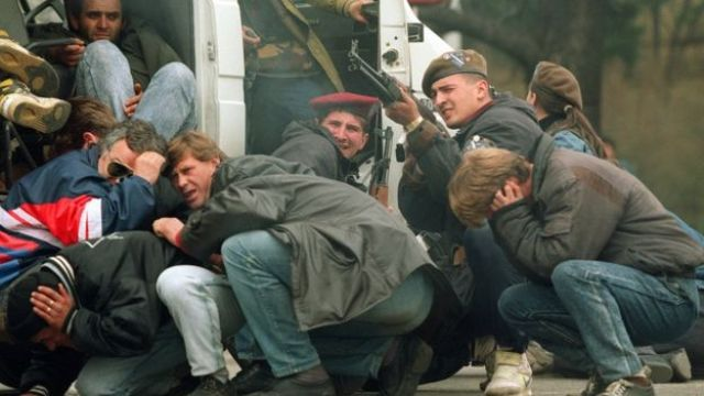 Civilians and Bosnian troops under Serbian sniper fire during the siege of Sarajevo in 1992
