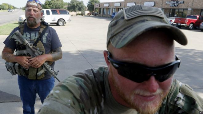 Terry Jackson, left, and Jonathan McCroskey, members of Operation Hero Guard, outside military recruiting station in Cleburne, Texas. 21 July 2015