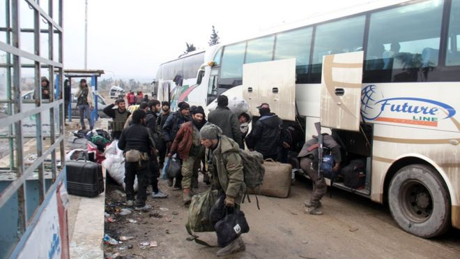 Syrian rebel fighters, arrive in the opposition-controlled Khan al-Assal region, west of Aleppo after being evacuated from the embattled city