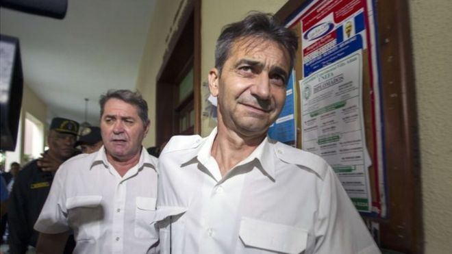 Pascal Fauret (left) and Bruno Odos leave the Court House in Santo Domingo after a hearing on May 8, 2014.