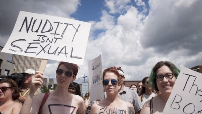 """Bare With Us"""" demonstrators gather at the Waterloo Town Square in Waterloo, Ontario, Canada, 1 August, 2015."""