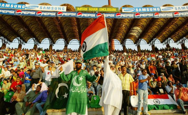 Pakistan and India supporters watch the match in the stands during the fifth Pakistan v India one-day international match played at the Gadaffi Stadium on March 24, 2004 in Lahore, Pakistan.