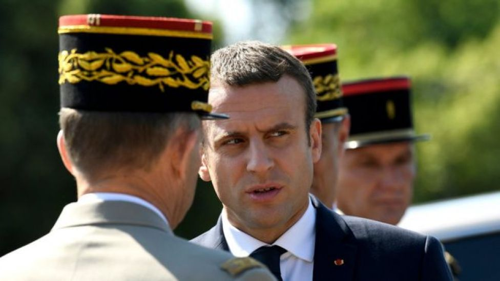 """French President Emmanuel Macron (C) speaks to an official during a ceremony marking to mark the 77th anniversary of General Charles de Gaulle""""s appeal of 18 June 1940, at the Mont Valerien memorial in Suresnes, near Paris, France, 18 June 2017"""