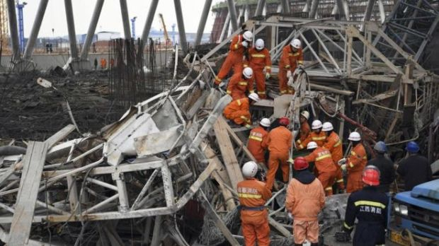 "In this photo released by Xinhua News Agency, rescue workers look for survivors after a work platform collapsed at the Fengcheng power plant in eastern China""s Jiangxi Province, Nov. 24, 2016"