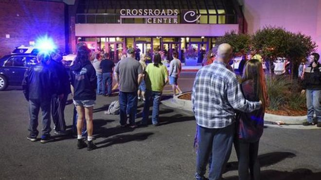 "People stand near the entrance on the north side of Crossroads Center mall between Macy""s and Target as officials investigate a reported multiple stabbing incident, Saturday, Sept. 17, 2016, in St. Cloud, Min"