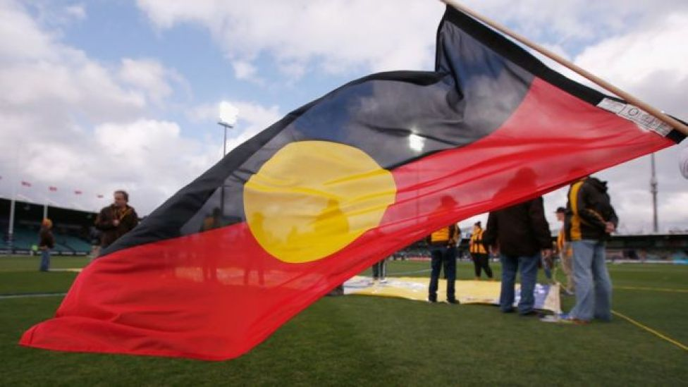 An Aboriginal flag is flown before a sporting match