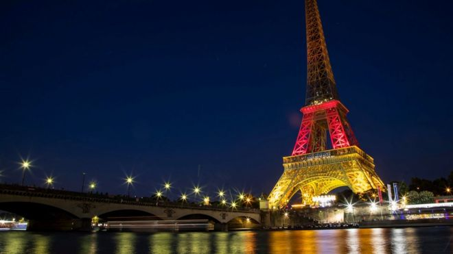 The Eiffel Tower is illuminated in the national colours of Germany to pay tribute to the victims of the 22 July Munich shooting attack, in Paris, France, 23 July