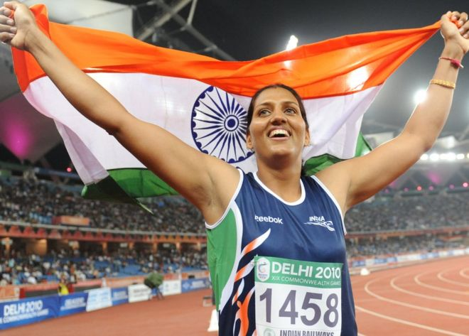 India's Krishna Poonia celebrates her gold medal during the discus women final of the Track and Field competition of the XIX Commonwealth Games on October 11, 2010 in New Delhi.