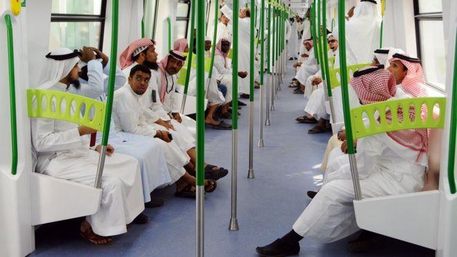 Saudi Arabian men ride on the newly-opened Holy Sites metro light rail in the western Saudi city of Mecca on November 2, 2010.