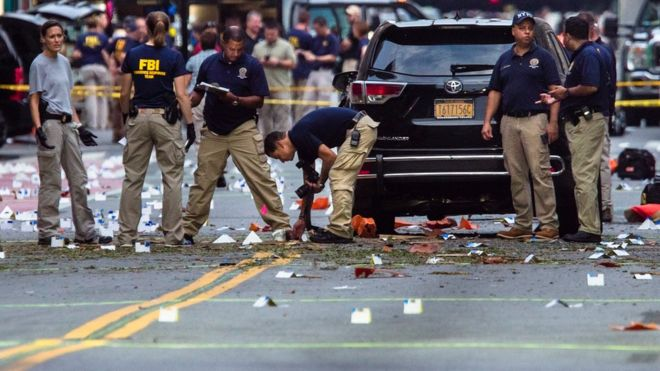 "Members of the Federal Bureau of Investigation (FBI) carry on investigations at the scene of Saturday""s explosion on West 23rd Street and Sixth Avenue in Manhattan""s Chelsea neighborhood, New York, Sunday, Sept. 18, 2016."