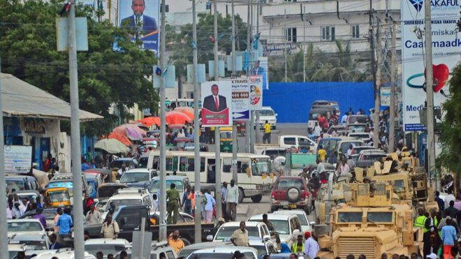 Traffic in Somalia's capital, Mogadishu, on streets with election campaign poster - December 2016