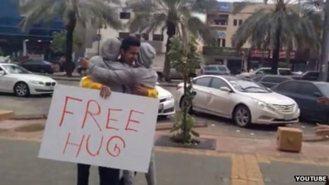 Grab from Bandr al-Swed's YouTube video showing him offering hugs in Riyadh