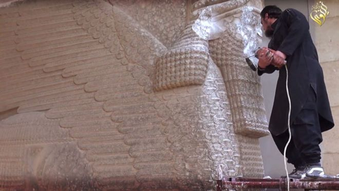 The so-called Islamic State defacing the Lamassu in Nineveh in 2015 (image: BBC)