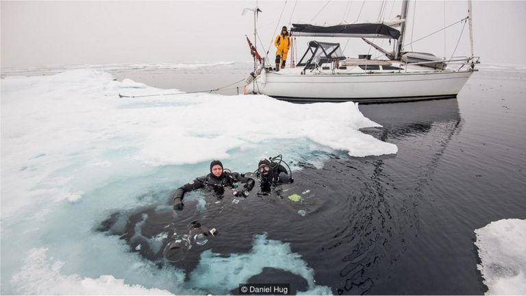The captain and author prepared to dive under the ice