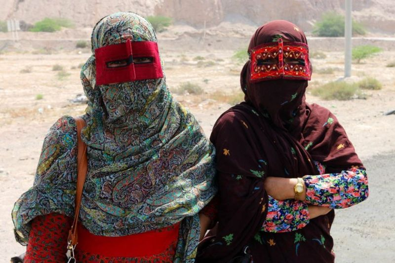 Shia Muslim Bandari women from southern Iran wearing embroidered Boregeh masks.