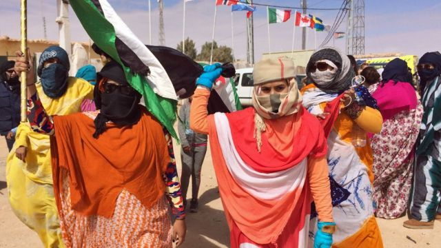Saharawi women ululate and fly the flag