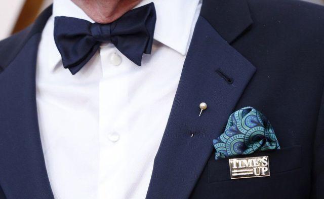 Richard Jenkins wearing a Time's Up pin