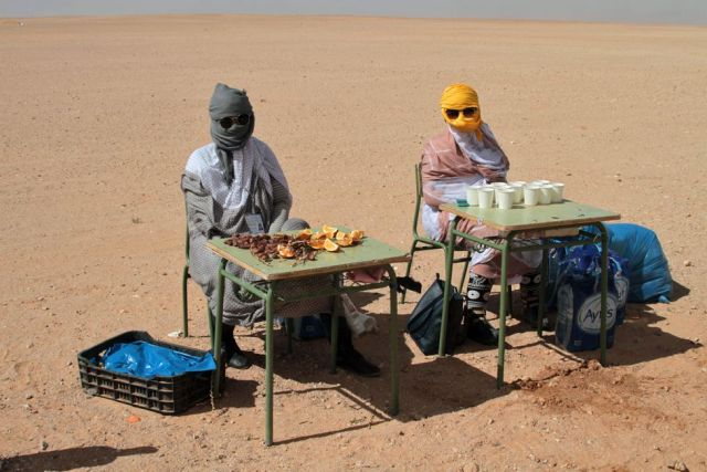 Women at a drinking station in the desert