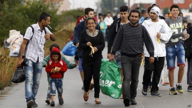 Migrants walk