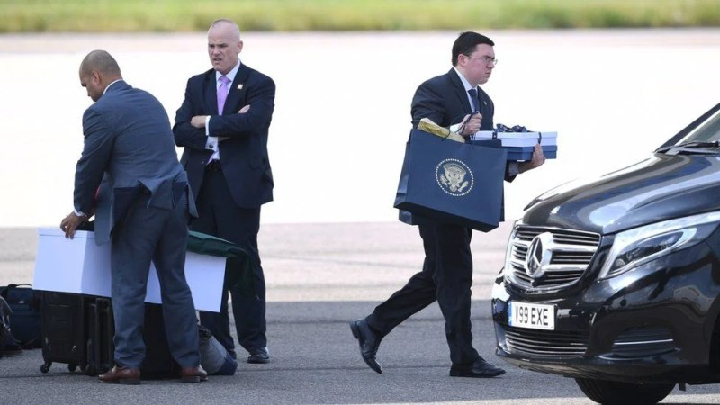 Items are unloaded from Air Force One following the arrival of US President Donald Trump and his wife Melania at Stansted Airport in Essex,