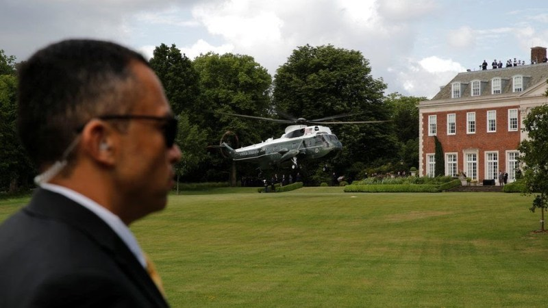 """A Marine One helicopter lands near Winfield House during U.S. President Donald Trump""""s state visit to Britain"""