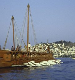 a replica ancient athenian warship trireme with volunteer british crew manning oars  [ 1280 x 720 Pixel ]