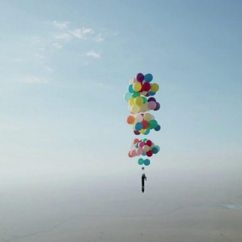 Chair With Balloons Turquoise Leather And Ottoman Man In 100 Camping Flight Bbc News