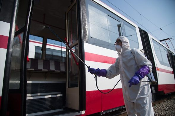 A worker disinfects a tram in Pyongyang