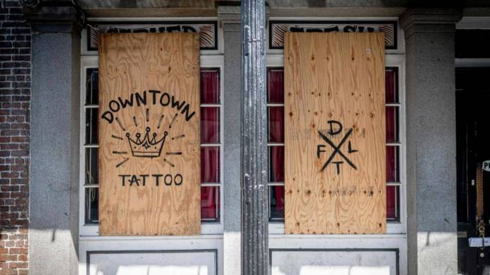 Boarded up shops in New Orleans