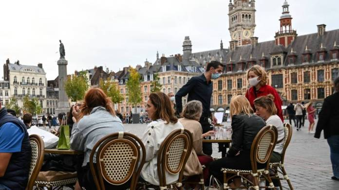 People sit at a cafe's terrace on September 9, 2020 in Lille, northern France.