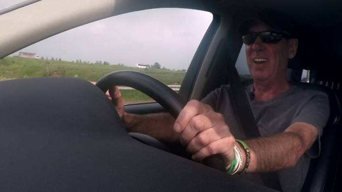 Jeff driving in his car