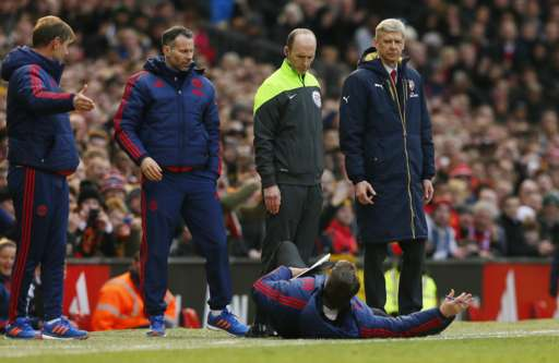 Louis van Gaal lies on the side of the pitch