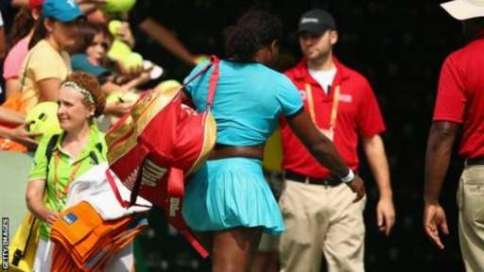 Serena Williams leaves the court