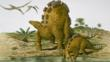 Wuerhosaurus adult and young by a pool