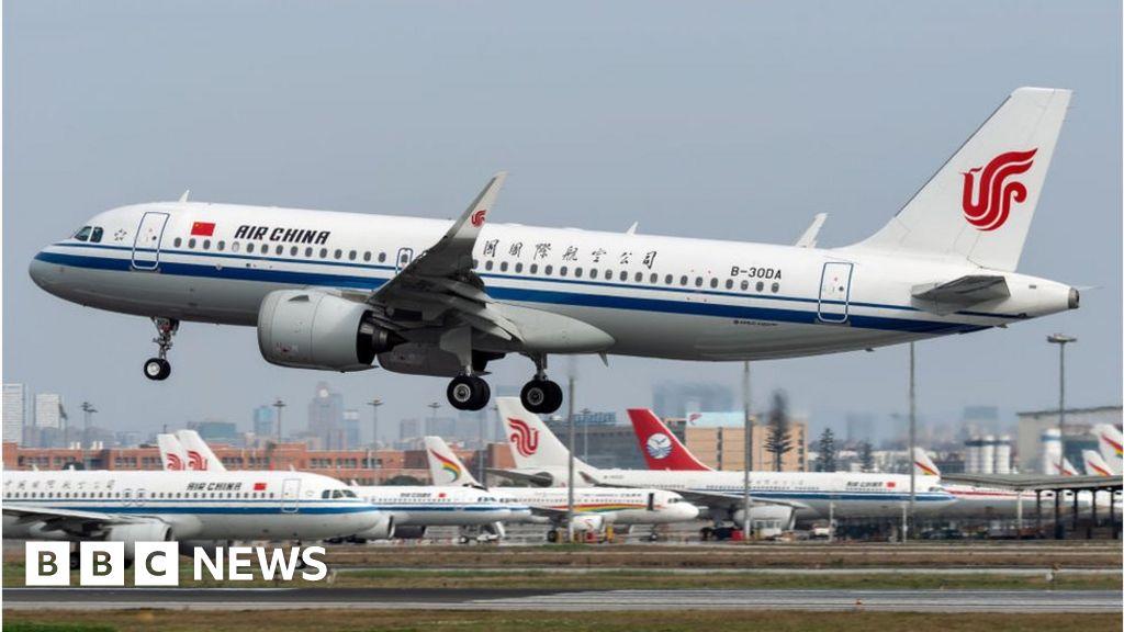 Coronavirus: China airline passenger numbers fall 84.5% - BBC News
