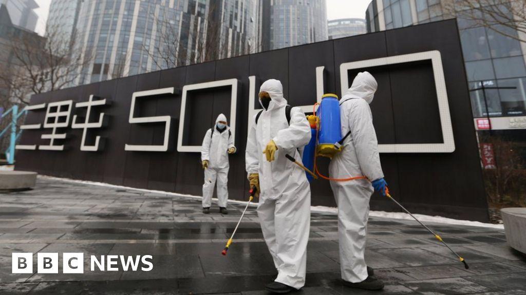 Coronavirus: Beijing orders 14-day quarantine for returnees - BBC News