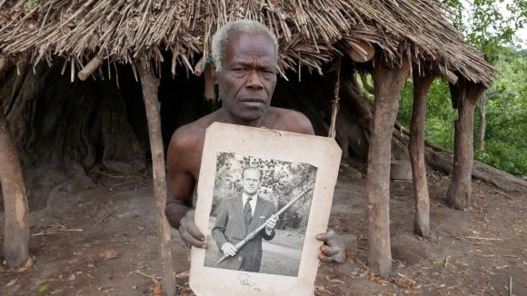 Village elder from Tanna island holds a picture of Britain's Prince Philip where he is worshipped in Yaohnanen, Vanuatu 6 May 2017